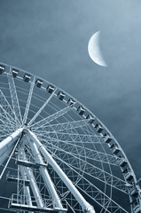 Ferris wheel in the evening at moonlight