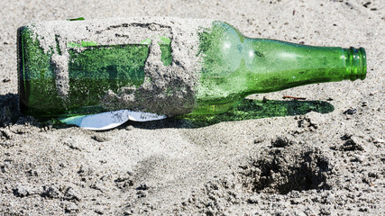 Abandoned bottle on the beach