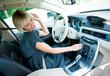 Leinwanddruck Bild - attractive woman listen radio in her car