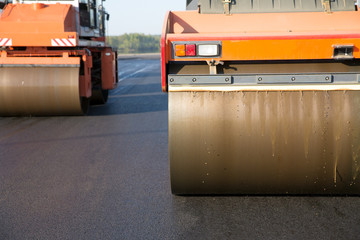 Road rollers during asphalt compaction works