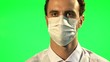 Doctor puts on mask and surgical gloves - green screen