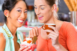 Female customers in Parlor with ice cream cone poster