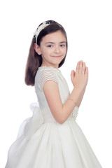 Adorable little girl dressed in communion
