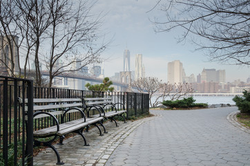 Brooklyn Bridge Park Bench and Walkway with Manhattan Skyline.