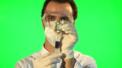 Scientist injecting blue liquid into bottle