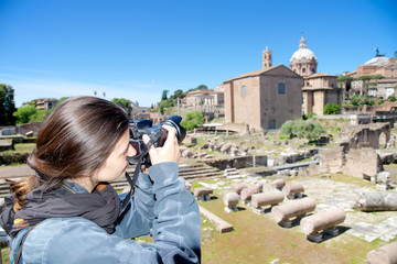 Girl tourist takes pictures in Rome, Italy