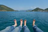 Bare feet against the sea