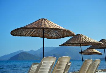 Beach umbrellas against the sea