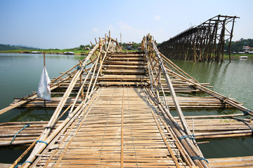 Bamboo bridge cross the river beside break wood bridge, Kanchana