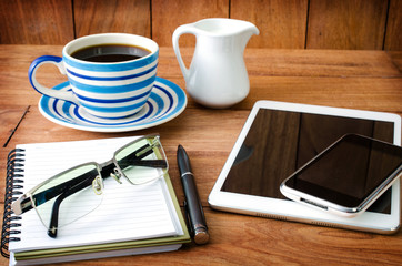 tablet pc and a coffee and Mobile phone