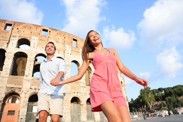Travel Couple in Rome by Colosseum running fun