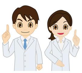 指を立てる白衣の男女
