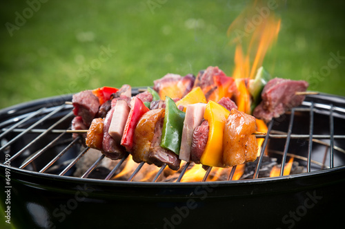 canvas print picture Tasty skewers on the grill.