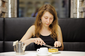 Woman having dessert in a cafe
