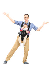 Father dancing and carrying his baby daughter