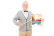 Mature teacher pointing with a stick on an abacus