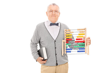 Mature teacher holding a book and an abacus