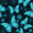 Blue butterflies and flowers seamless background