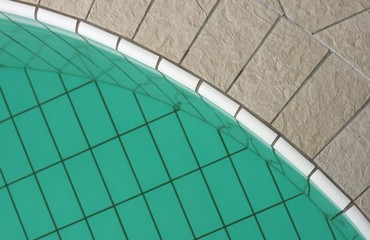 Woman's foot on the edge of a swimming pool