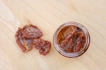 Home made sun dried tomatoes in olive oil in glass jar