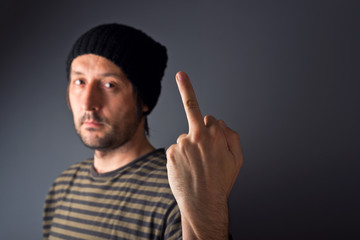 Punk giving middle finger, rude gesture