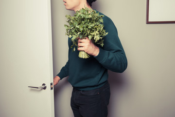 Surprised man with parsley answering the door