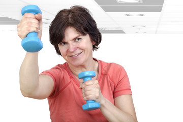 Woman with dumbbells during sport
