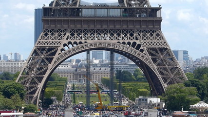 Base of the Eiffel Tower and the traffic in Paris, France