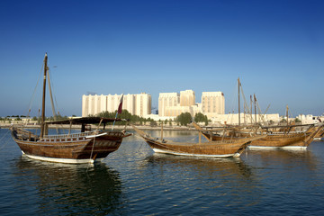 Old boats in the modern city of Doha