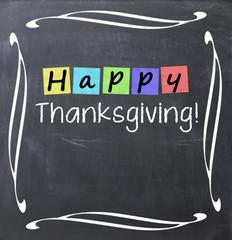 Happy thanksgiving text written on blackboard