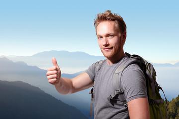 happy man mountain hiker