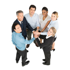 Businesspeople With Hands Stacked
