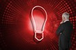 Composite image of light bulb and businessman looking