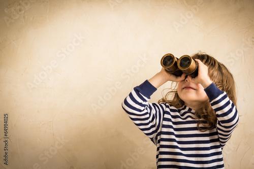 Leinwandbild Motiv Happy kid looking ahead