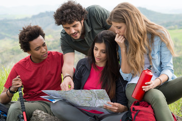 Group Of Hikers Looking The Map