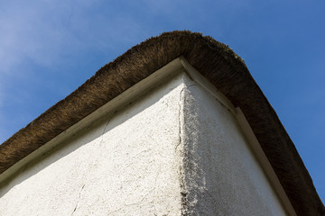 Corner of thatched cottage roof