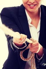 Business woman pulling on a piece of rope