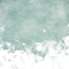 Sky, fog, and clouds on a textured, vintage paper background wit