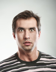 Close-up portrait of a shocked man