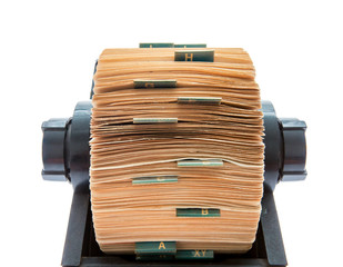 Old original rotary rolodex isolated on white