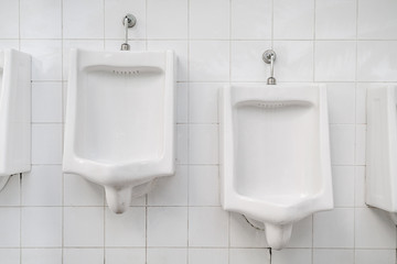 White urinals for men and boys in public toilet