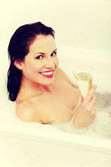 Beautiful woman relaxing during the bath.