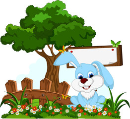 cute rabbit cartoon with blank board in flower garden