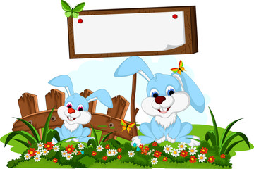 cute couple rabbit cartoon with blank board in flower garden