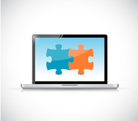 laptop computer and puzzle pieces