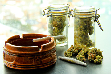 Marijuana Joints and Jars of Weed