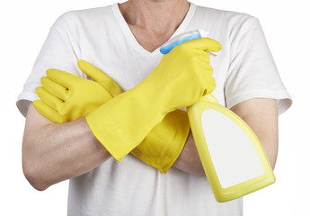 Studio shot of a man with rubber glove holding a cleaning spray