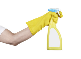Studio shot of a hand with rubber glove holding a cleaning spray