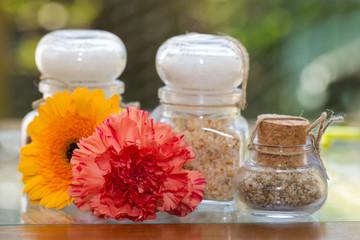 Seasoned salt in jars with flowers