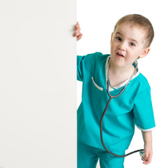 little boy in doctor suit behind blank banner isolated